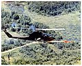 Helicopter firing Hellfire missile in flight.jpg