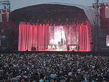 A Man Performing On Stage In Front Of Capacity Crowd Rod Stewart At Home Park