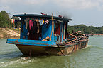 Hue Vietnam Freight-ship-on-the-Perfume-River-01.jpg