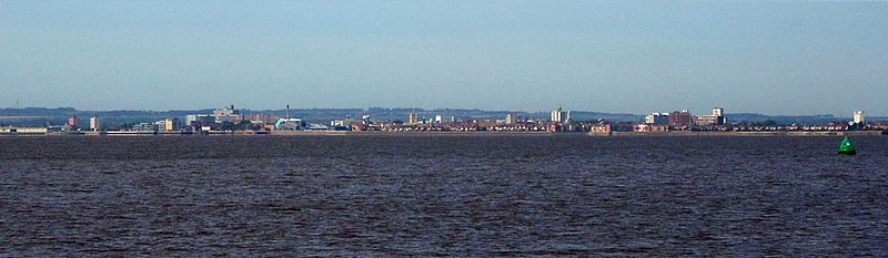 Panorama of Hull from the north bank of the Humber near Paull, with the hills of the Yorkshire Wolds rising behind the city