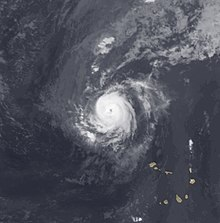 A satellite image depicting a small tropical cyclone in the eastern Atlantic Ocean.