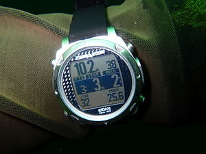 Dive computer - iDive DAN personal dive computer display showing decompression requirement and other data during a dive The central band shows time to surface from current depth, stop depth and stop time.