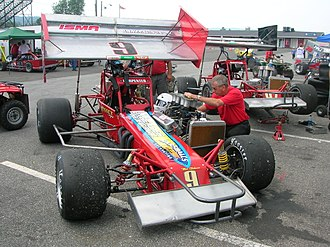 Modified stock car racing - ISMA SuperModified. Note the extreme offset to the driver's side, and the engine mounted outside of the frame rails.
