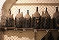 Imola, palazzo tozzoni, cantine, bottiglioni di vino dal 1845 al 1910, 01.jpg