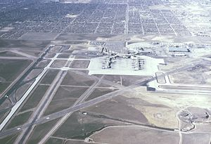 Stapleton International Airport - Looking west, January 1966. Only concourses A, B, and C existed then. A United Airlines Pilot Training Center was later built on the vacant land between the airport's west boundary and the housing tracts.