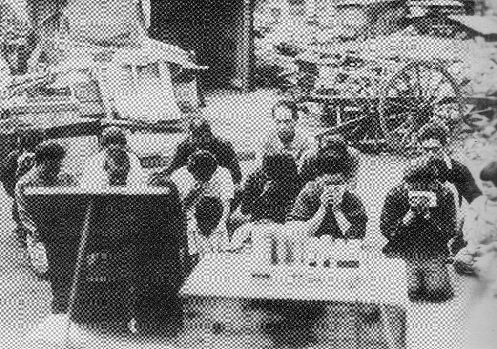 Japanese civilians listening to the surrender broadcast
