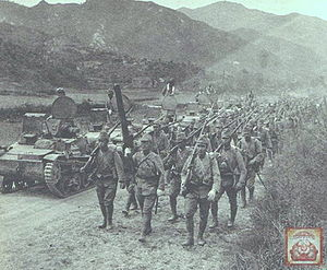 Japanese soldiers and tanks marching towards Sung-pu and Huang-an beyond Ta-pieh Mountains.jpg