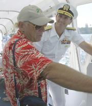 Jimmy Buffett tours Pearl Harbor with United States Navy Admiral Jonathan Greenert, June 12, 2003