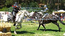 Tilting with a lance at a Renaissance Fair.
