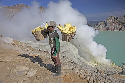 A man carrying sulfur blocks from Kawah Ijen, a volcano in East Java, Indonesia, 2009 Kawah Ijen -East Java -Indonesia -sulphur-31July2009.jpg
