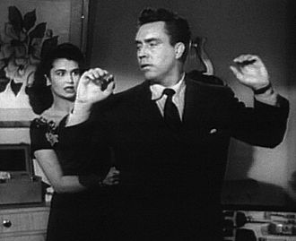 D.O.A. (1949 film) - Marla Rakubian threatens Bigelow when he comes to her for information.