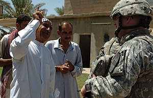 Operation Phantom Strike - Col. David W. Sutherland, commander of coalition forces in Diyala province, Iraq, speaks with Sheik Sammi, a tribal leader in Sheik Sa'ad Village, to ensure that the local citizens feel secure and are being treated with respect during Operation Lightning Hammer, 14 Aug 2007