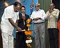 M. Veerappa Moily lighting the lamp to inaugurate the National Workshop on Fuel Conservation Opportunities in Transport Sector, in New Delhi. The Secretary, Ministry of Petroleum and Natural Gas, Shri Vivek Rae is also seen.jpg