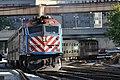 METX 211 Departs Chicago Union Station (4925229097).jpg