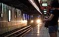 MRT rolling stock into Nangang Station platform 20140920.jpg