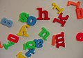 Magnetic letters scattered on a refrigerator door.jpg