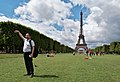 Man attempting to hold the tip of the Eiffel Tower (DSC 0253).jpg