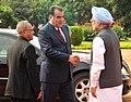 Manmohan Singh meeting the President of the Republic of Tajikistan, Mr. Emomali Rahmon at the ceremonial reception, at Rashtrapati Bhavan, in New Delhi. The President, Shri Pranab Mukherjee is also seen.jpg