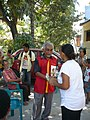 Marí Bin Amude Alkatiri during the FRETILIN campaign. Door-to-Door campaign handing out flowers to citizens.jpg