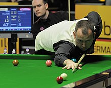 Mark Williams playing a shot