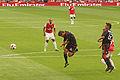 Mathieu Flamini clears a corner (4867592096).jpg