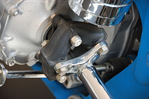 Flexure bearing - A Giubo driveshaft coupling, another type of flexure bearing, on the right hand rear driveshaft of a formula 2 race car. This coupling has two compliant degrees of freedom to allow rotation of the shaft with some misalignment.