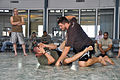 Matt Mitrione & Chris Lytle demonstrate fighting maneuvers (110929-A-GI410-144).jpg