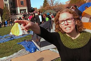 "2015–16 University of Missouri protests - A frame from Schierbecker's video made famous by social media: Melissa Click tells Schierbecker ""you need to get out."" and later yells ""I need some muscle over here"""