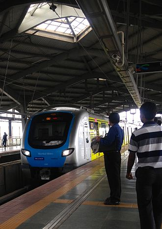 Mumbai Metro - Metro trains arriving at different stations.