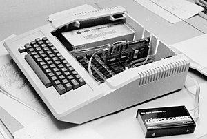 "Hayes Microcomputer Products - Micromodem II installed in an Apple II. The external ""microcoupler"" with the phone jacks and analog hardware were connected via the ribbon cable."