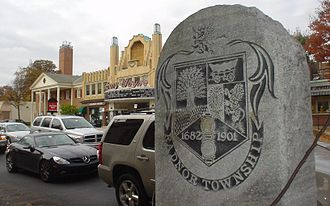 Radnor Township, Delaware County, Pennsylvania - Memorial mile post on U.S. 30 in front of the Anthony Wayne Theater and the AT&T tower in the background.