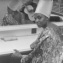 Makeba seated at a counter