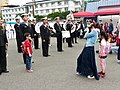 Mother Photographing Son with ROCN Band after Event 20140327.jpg