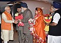 Narendra Modi being received by the Governor of Punjab, Shri Vijayendrapal Singh Badnore, the Chief Minister of Punjab, Shri Parkash Singh Badal, the Union Minister for Food Processing Industries (1).jpg