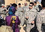 National Guardsmen distribute school supplies DVIDS342536.jpg
