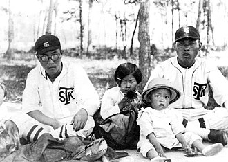 No Kum-sok - No as a toddler in 1935, with his father, who was a baseball player.
