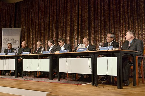 Peter Diamond, Dale T. Mortensen, Christopher A. Pissarides, Konstantin Novoselov, Andre Geim, Akira Suzuki, Ei-ichi Negishi, and Richard Heck, Nobel Prize Laureates 2010, at a press conference at the Royal Swedish Academy of Sciences in Stockholm. Nobel Prize 2010-Press Conference KVA-DSC 8019.jpg