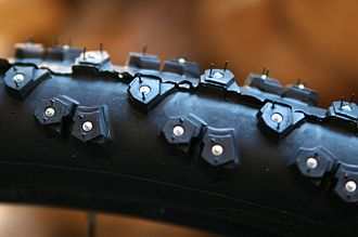 Tungsten carbide - A Nokian bicycle tire with tungsten carbide spikes. The spikes are surrounded by aluminum.