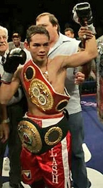 Nonito Donaire - Donaire with the IBF (red) and IBO (black) titles, 2007