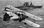 O2U-2 Corsairs of VS-14M fly over USS Saratoga (CV-3), circa 1930 (NH 94899).jpg