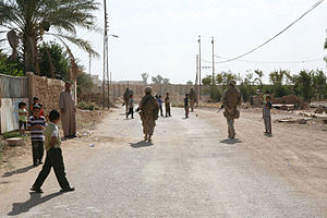 3rd Light Armored Reconnaissance Battalion - Scouts from 3rd LAR patrol the streets of Anah, Iraq (2006).