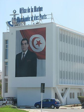 Large photographs of Ben Ali were widespread in Tunisia. This example was at the Office of Merchant Navy and Ports building. Office of Merchant Navy and Ports.jpg
