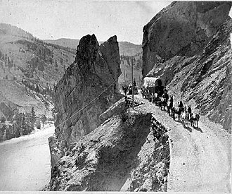 Cariboo Road - Horse drawn freight wagons on the Cariboo Road along the Thompson River, 1867