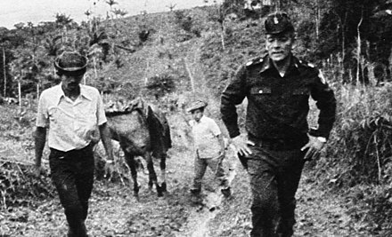 Omar Torrijos (right) with farmers in the Panamanian countryside. The Torrijos government was well known for its policies of land redistribution. Omar Torrijos with Panamanian farmers.jpg