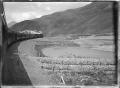 Otira to Christchurch Express train on a bend alongside the Waimakariri River. ATLIB 288018.png