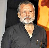 Pankaj Kapur is posing for the camera