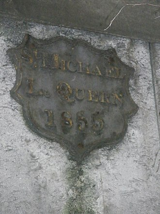 St Michael-le-Querne - Parish boundary mark on wall of St Paul's Choir School