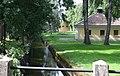 Parken och Tumbaån med Spruthuset i bakgrunden vid Tumba Pappersbruk.jpg