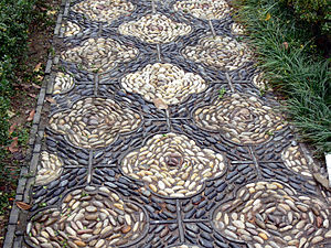 Pebble - A walkway decorated with pebbles set into concrete.