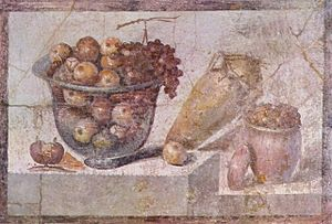 Still life - Glass bowl of fruit and vases. Roman wall painting in Pompeii (around 70 AD), Naples National Archaeological Museum, Naples, Italy